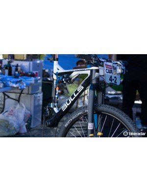 The top riders have their bikes near stripped every evening. Here, a Bulls mechanic replaces frame pivot bearings after only two stages