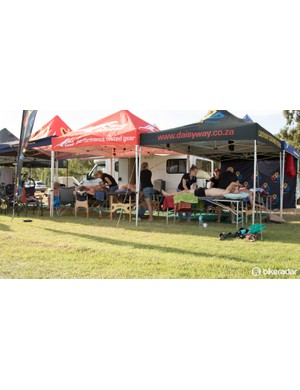The 'second camp' at the event village plays host to not just bike stores, but physios too