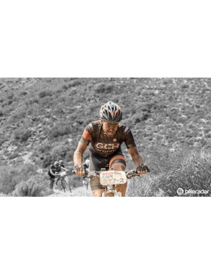 Nearing the end of a stage, this rider pushes himself to the point of a moan