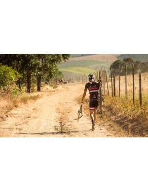A destroyed front wheel means a long walk ahead for this rider on stage 5 of the 2015 Absa Cape Epic