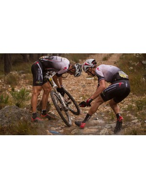 The rugged nature of the Cape Epic means even the top guys need to contend with mechanicals. Here, eventual men's winners Karoslav Kulhavy and Christoph Sauser fix one of many flats