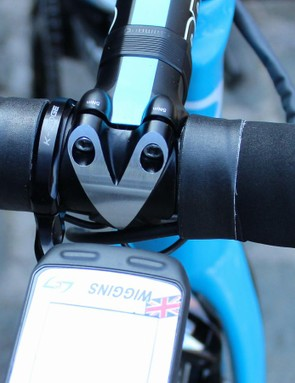 Wiggins had his tape wrapped right up to the stem