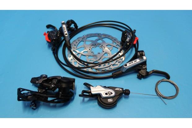 Shimano SLX brakes, rear shifter and Shadow Plus rear mech