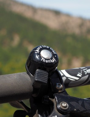 A bell is standard equipment on any mountain bike I ride - personal or otherwise. I can't begin to tell you how many times a hiker or equestrian has thanked me for the ding, which not only sounds friendlier than the usual