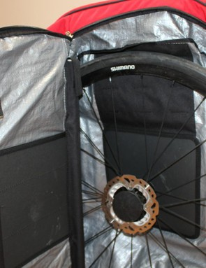 Wheels slot in easily to dedicated pouches with sturdy pads for rotors and the cassette