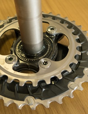 The chainrings are installed from the back. Note the carbon 'larger' chainring with steel teeth