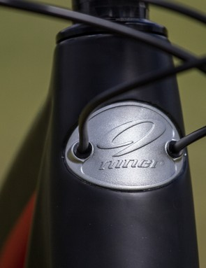 Internal gear cable routing enters at the head badge