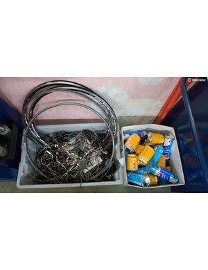 Notable items in the rubbish include: chains, cables, tins of tubular glue, and broken Mavic Reflex tubular rims