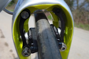The behind-the-fork brake works surprisingly well, but is a fiddle to set up