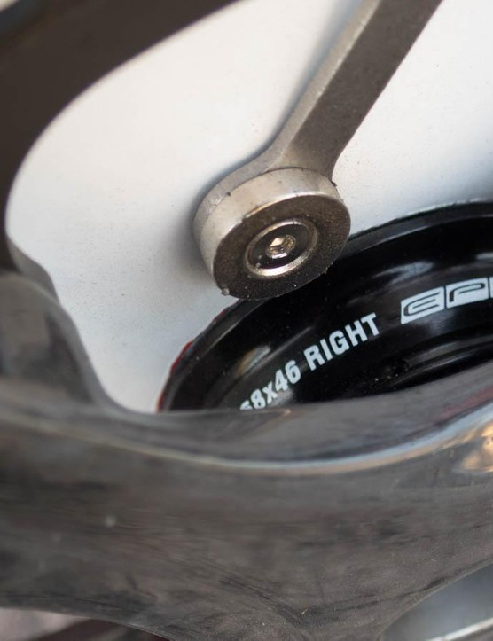 The magnet on the end of the chain catcher, plus Campagnolo's PF30 adapter cups