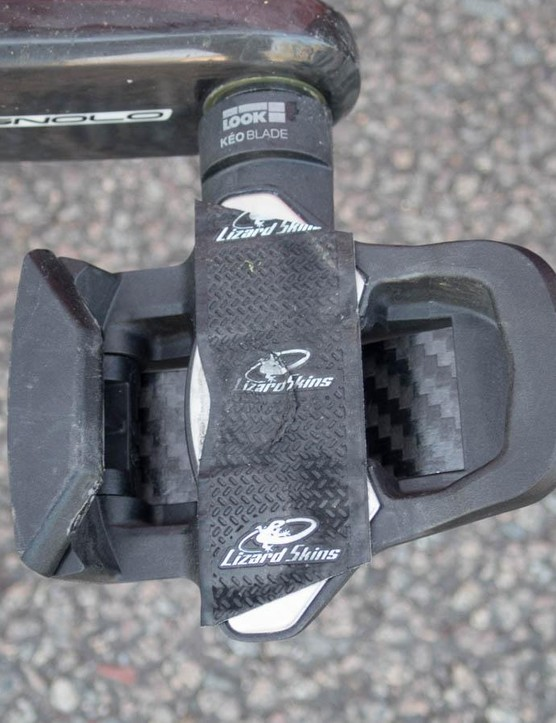 Like many riders, his pedals are modified with bar tape to improve cleat fit and silence creaks