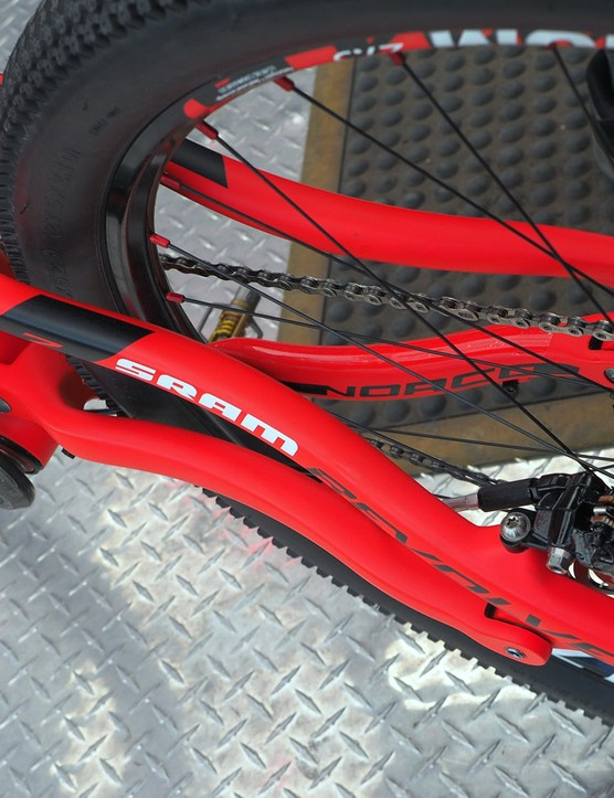 Both the seatstays and chainstays are dramatically bent so as to boost heel clearance
