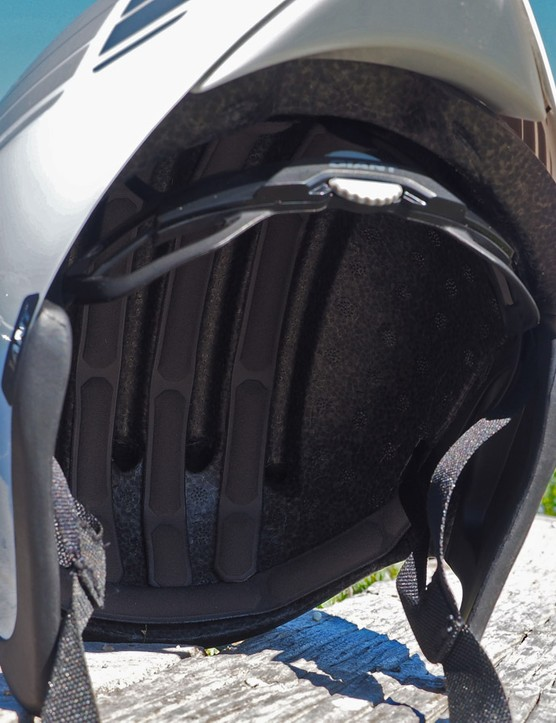 The flexible ear covers help maintain a trim profile on the new Giant Rivet TT helmet but the internal channeling and various air vents promise to keep things comfortable in warm weather, too