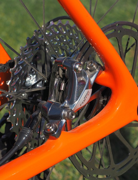 The rear brake caliper bolts to post mount tabs while the Syntace X-12 thru-axle rear end maintains a clean appearance