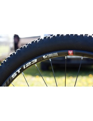 WTB ST rims feature a 23mm internal diameter and after taping and sealant will be fine to run tubeless