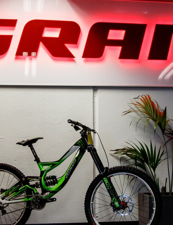 Greeting entrants is the bike of world cup downhiller Troy Brosnan