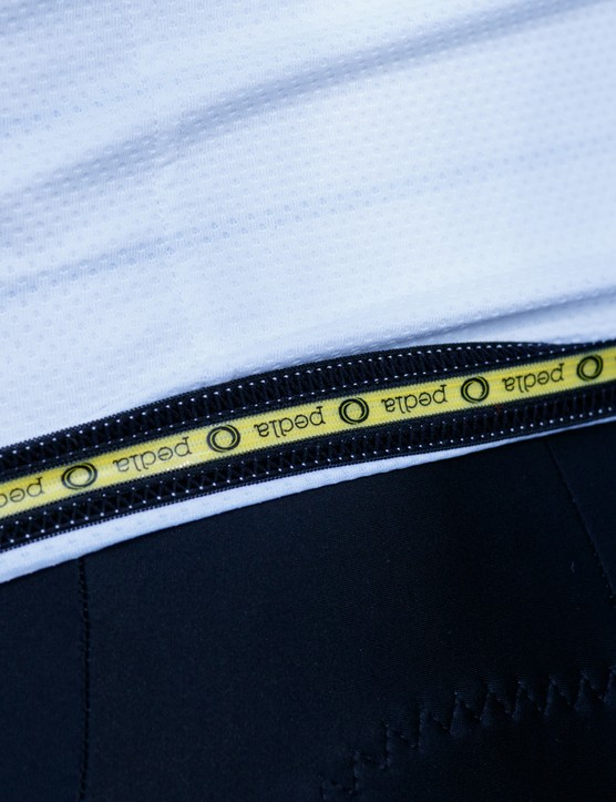 A silicone gripper keeps the bottom of the jersey from bunching up
