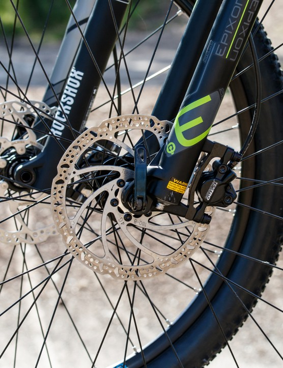 Both forks share similar features in the way of an air spring, adjustable rebound control and remote lockouts, but they're far from being equal on the trail with the hardtail's RockShox offering a more secure and confident hold