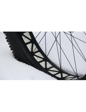 The Specialized Fatboy SL rims feature a latticework of cutouts to save weight