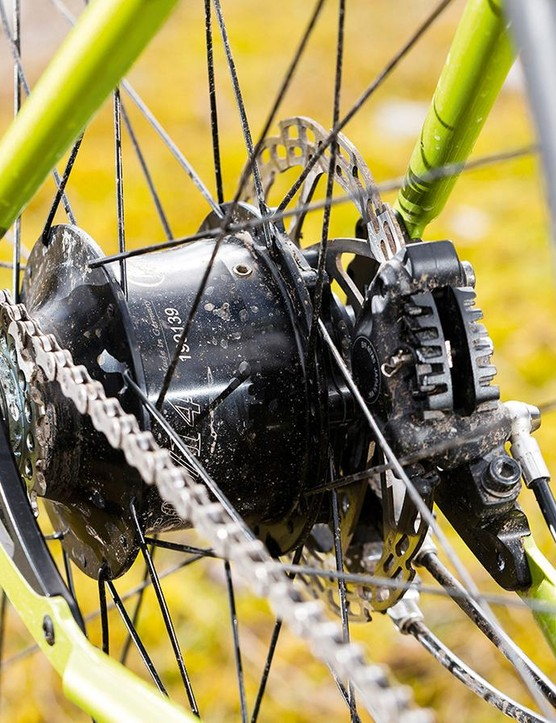 The Rohloff hub puts all those delicate cogs and shifty bits inside the hub of the rear wheel, where they can't be soaked in mud or ripped off by an angry tree