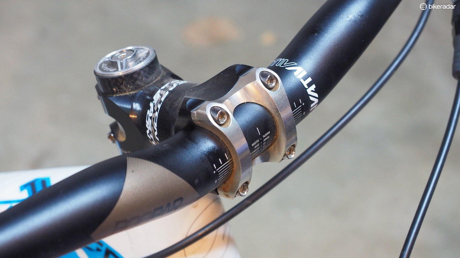Handlebar clamps are prone to creaking, especially with metal-on-metal interfaces. Mark the handlebar position with a permanent marker and remove the faceplate clamp. Clean everything off, apply friction paste to all of the mating surfaces, grease the bolt threads, and then reinstall, being sure to tighten to proper torque