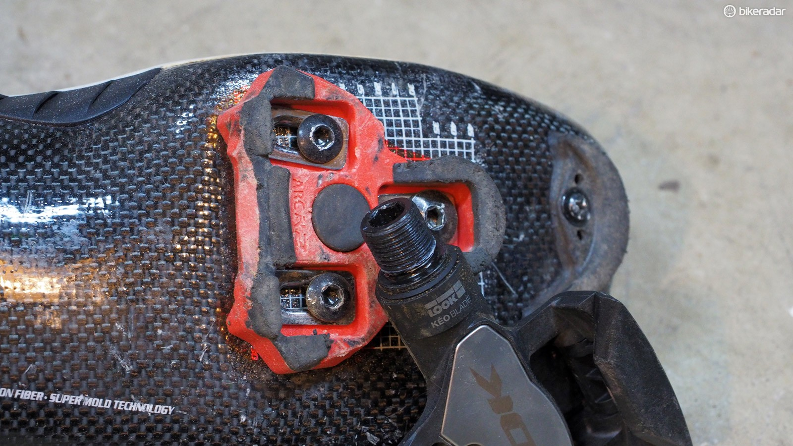 Yup, pedals and cleats can creak, too. Clean the cleats and spray them down with a wax-based furniture polish. Remove the pedals from the cranks, clean and regrease the threads, and reinstall