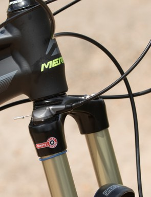 The front suspension fork features a handlebar remote lockout