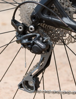 A Shimano Deore Shadow Plus rear derailleur may not seem like anything fancy, but it performs superbly well and helps keep the chain silent on rough terrain