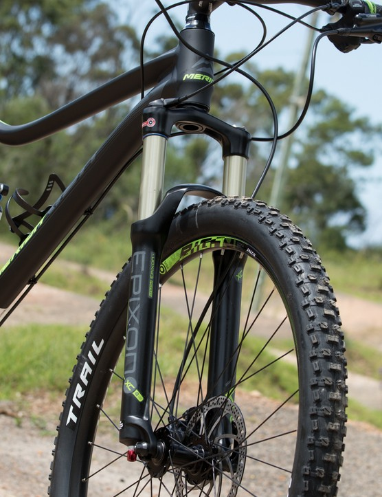 The SR Epixon XC RL-R fork isn't terrible; it offers respectable dampening control and air spring adjustment. However, it's a little flexy with its straight steerer and quick release axle, and repetitive hits seem to overwhelm the damper - leading to a spike felt through the hands