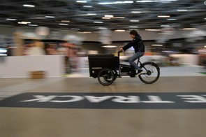 The indoor test track was busy all weekend. This Butchers & Bikes leaning electric-boosted cargo bike was thundering up and down with alarming pace