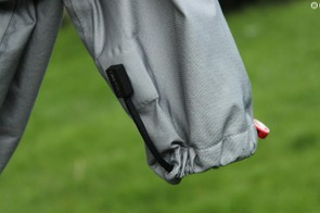 The hems can be cinched up, with a magnet holding the string out of the way