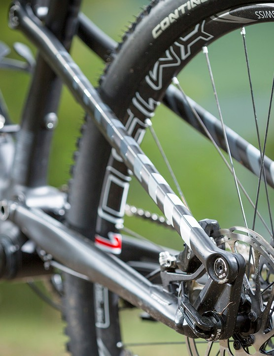 The Spine uses a 142x12mm thru-axle with the rear brake caliper mounted to the chainstay