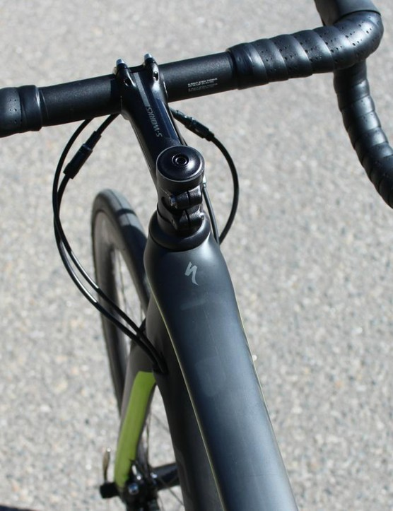 The top tube flares around the frame-size-specific head tube. The bars are the comfortable shallow-drop (123mm) Specialized Expert