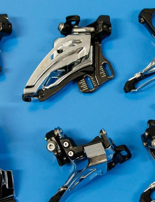 Front derailleurs on blue background