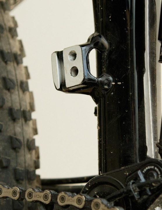 Pictured is an empty direct mount (high direct mount) post. This particular one features two bolt holes for greater height adjustment for various chainring sizes, most frame mounts typically offer just one hole