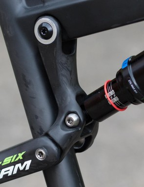 This new carbon link plus moving the shock to the top tube has saved around 100g