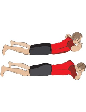 Here's how to do back extensions – lie on your front then lift your torso