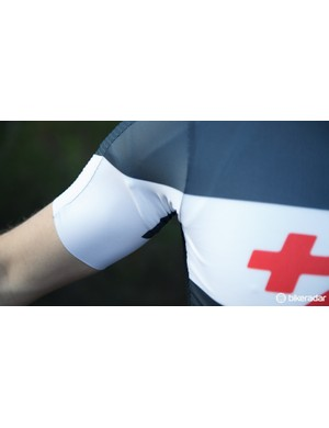 The arms are cut to free of excess material when in a narrow on-bike position