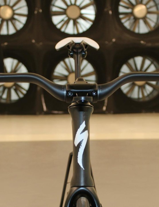 Recipe for aero: short, narrow head tube; narrow fork without caliper on the fork or inside the legs; dropped stem that houses cabling; inline Garmin mount