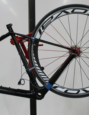 D'Alusio and Pickman tested wheel/frame deflection at three points: at the seatstays, at the chainstays and in the middle of the seat tube