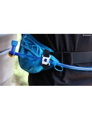 The hydration tube is wraps around the waist and is secured with Camelbak's magnetic Tube Trap