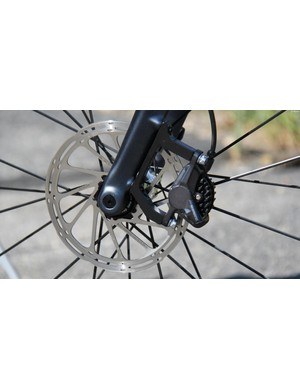 The fork uses a thru-axle and direct-mount for the brake caliper