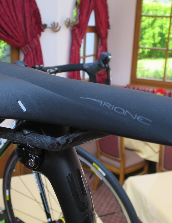 It's a carbon-railed Fizik Arione for the Black Inc.