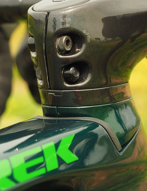 Since the cables run down alongside the steerer tube and through the upper headset bearing, it'd be a nightmare to raise or lower the stem with conventional spacers. Instead, Trek cleverly uses split spacers that can be inserted or removed without having to undo everything