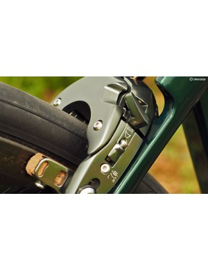 There are separate, independent adjustments for both arm position and spring tension on each side. They're clearly marked, too, to help with setup and maintenance. A tidy quick-release lever is built into the caliper, too