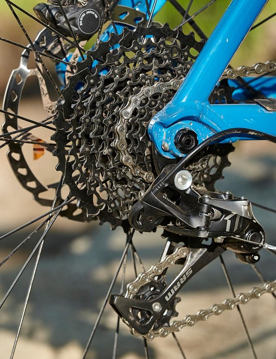 The mixed 1x11 drivetrain works well but we'd fit a bigger front chainring to cut bob