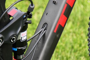 There's an exit port on the top of the downtube for the rear brake, rear derailleur and (in this case) the remote lockout