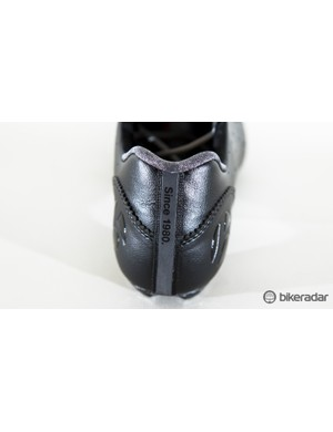 A strip of reflective tape runs down the heel