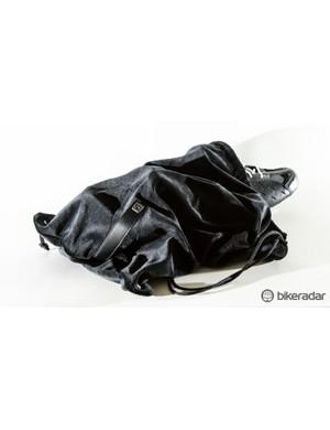 A velvet shoe bag made us feel like Heff