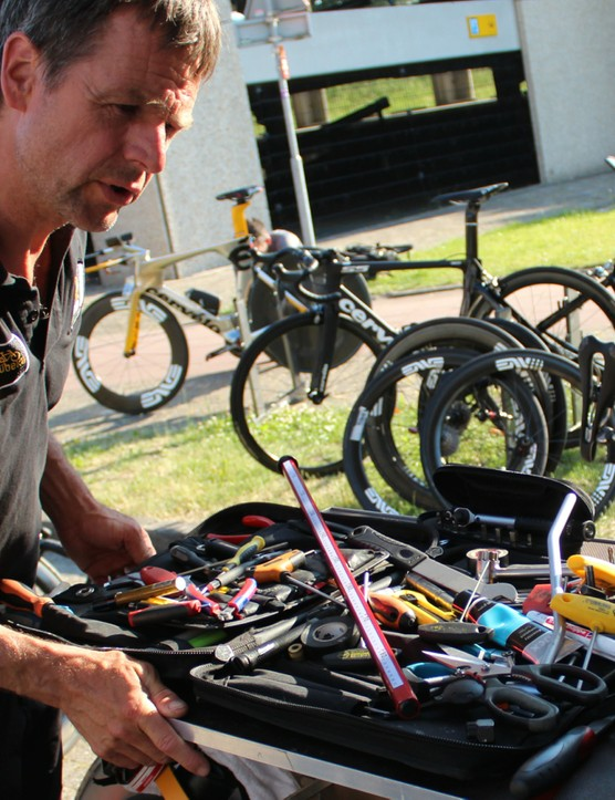 MTN Qhubeka mechanic Stef van Zundert consults his notes on rider specs while assembling bikes